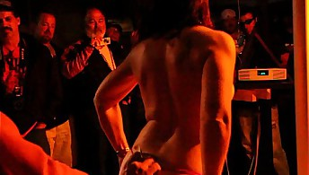 Biker babe strips on pole in Sturgis