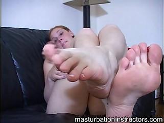 Masturbation teacher shows a footjob demo