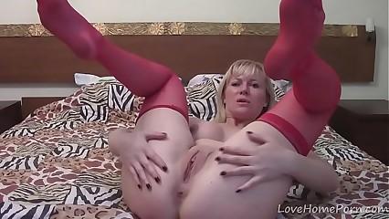 Milf in red stockings loves fingering herself