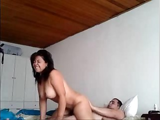 Homemade video of a Cuban guy fucking a latina MILF