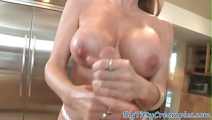 Busty mature titfucked at the kitchen