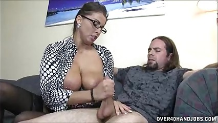 Busty Milf Enjoys Jerking A Dick
