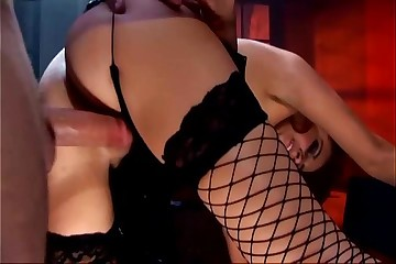 Pretty brunette fucking in black fishnet stockings