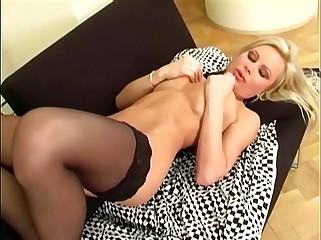 Blonde fingering her shaved pussy