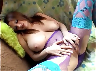 Busty amateur masturbates in fishnet pantyhose