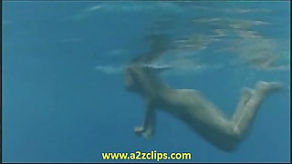 023 Phoebe Cates - Paradise (stripping-swimming nude underwater)