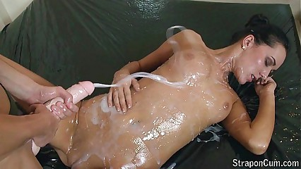 User requested: Oiled strap-on play