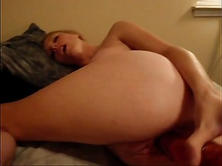 RedHead Plays w/ dildo in her ass and pussy
