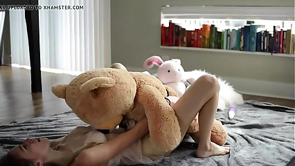 Petite young blonde riding a teddy - evilcams.net