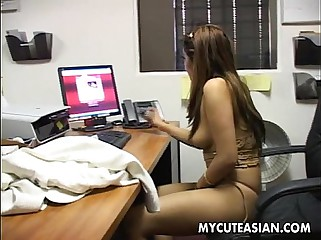Asian slut has a wank job on a leather chair