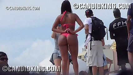 Tan Latina with big butt PAWG in a thong bikini on the beach!