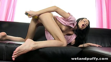Skinny chick plays with a speculum