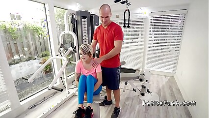 Trainer fucks petite blonde in the gym