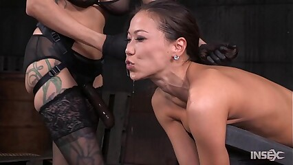 Slender Asian slut fucked hard by lezdom strap on