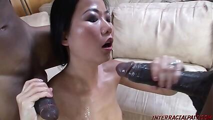 Asian takes 2 monster black cocks