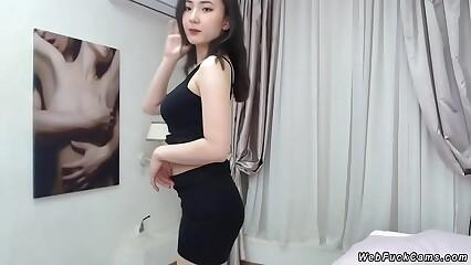 Busty petite Asian posing on cam