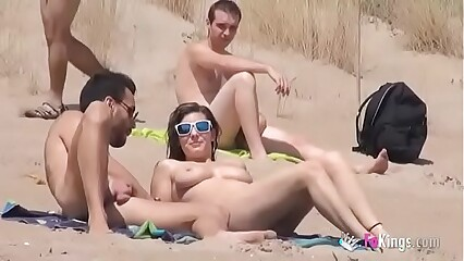 Sol fucks a guy in a beach surrounded by voyeurs