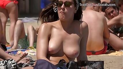 Nice woman Topless on the Beach