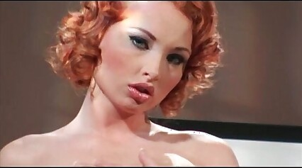 Curly redhead bitch takes two big cocks