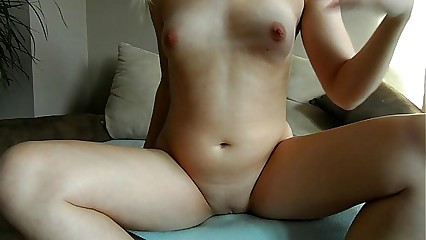 Sophie in red lingerie and high heels plays with toys