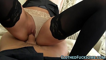 Clothed skank sucks cock