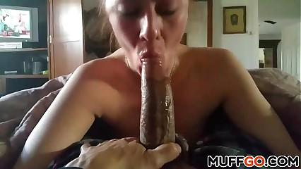 Redhead deepthroats big black cock