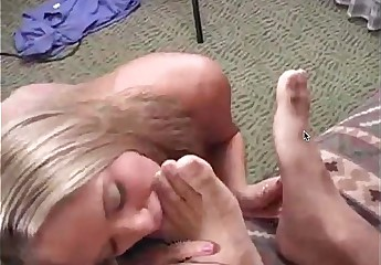 Blonde licking feet