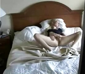 Caught my cute mom on bed fingering pussy. Hidden cam