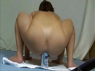 Amateur slut fisting her ass with huge bottle. Extreme