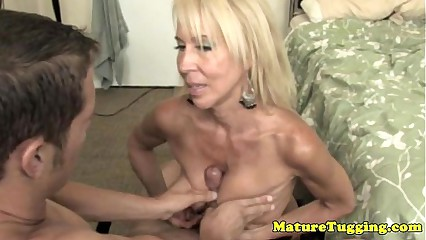 Handjob loving granny pampering dick