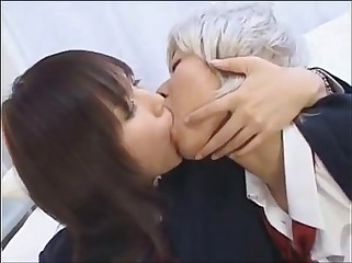 Japanese Lesbian Schoolgirl Kissing Another Girl in Drag