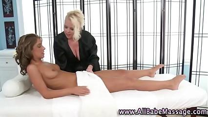 Busty lesbian masseuse licks wet pussy