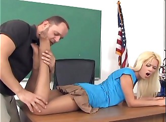 Petite blonde Rebecca giving a footjob in nylon