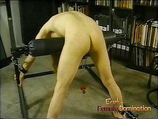 Horny dude with long hair enjoys being whipped by his dominatrix