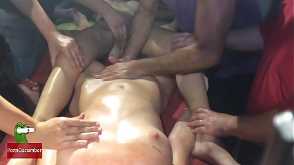Two naked lesbians enjoy a sex massage in public
