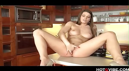Stacked sexy brunette kitchen fingering