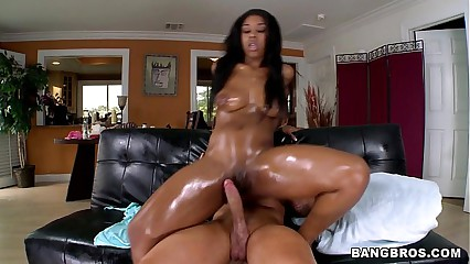 Oiled Black Chick gets White Cock to play with