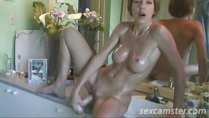 Short Haired Bathroom Babe Pussy Play