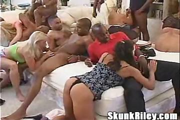 Skunk Riley's Big Black Dick Gangbang Orgy
