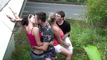 Cum on a chubby girl with big tits in extreme public foursome sex by a highway