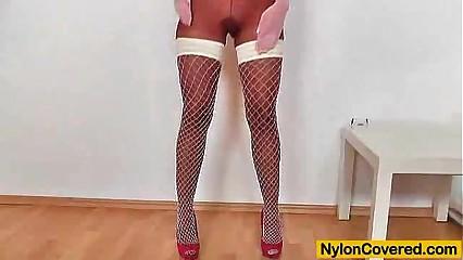Stunning skinny beauty wears sky-high heels and nylons pantyhose on her nice lon