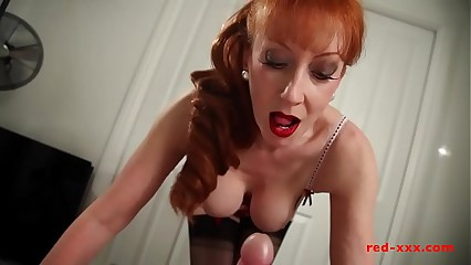 Horny big tit redhead MILF gives her man a wank