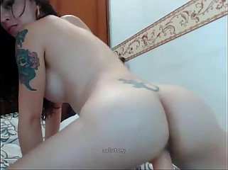 Tattooed girl riding a big dildo on livespicycams.com