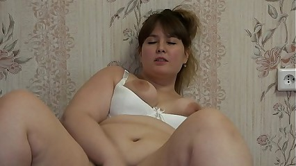 A fat girl masturbates and pushes fruit into her hairy pussy