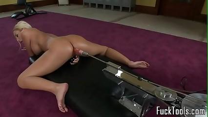 Masturbating blonde toys pussy using dildo
