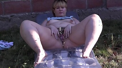 Bbw lot of pissing outdoors, golden streams of urine glisten in the sun.