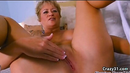 Mature blonde rubbing her clit