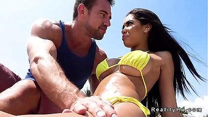 Huge tits Latina in bikini at beach