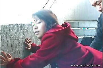 Cute Asian giving a hot outdoor blowjob