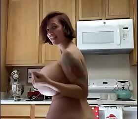 Brittany Elizabeth in the kitchen dancing naked